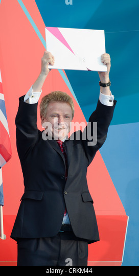 Colin Moynihan  holds IOC  Official Invitation to the Games ' 1 year to go to'  London 2012 Olympics Trafalgar - Stock Image
