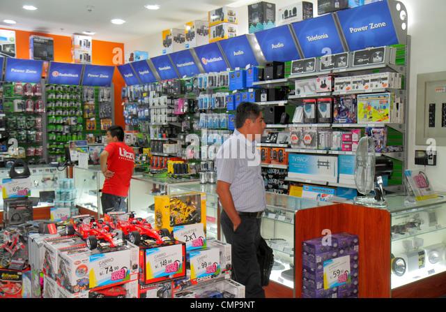 Lima Peru Estacion Central station Metropolitano Bus Line transportation hub shopping retail store business Radio - Stock Image