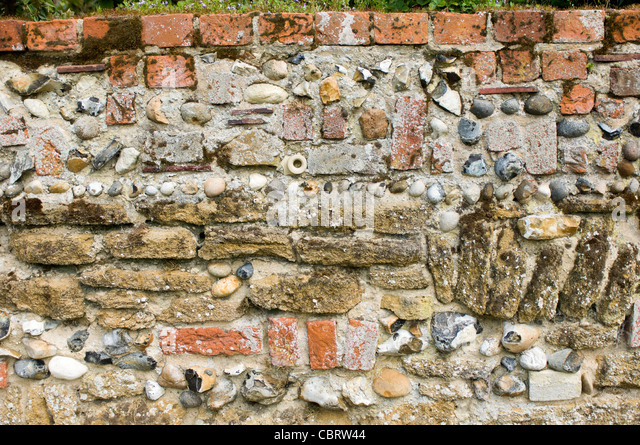 Flint and mortar stock photos flint and mortar stock for Mixing brick and stone