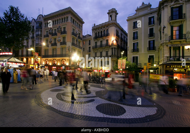 Spain Barcelona Las Ramblas dusk tourists mosaic by Joan Miro - Stock Image