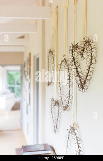 Wall hangings in rustic hallway - Stock Image