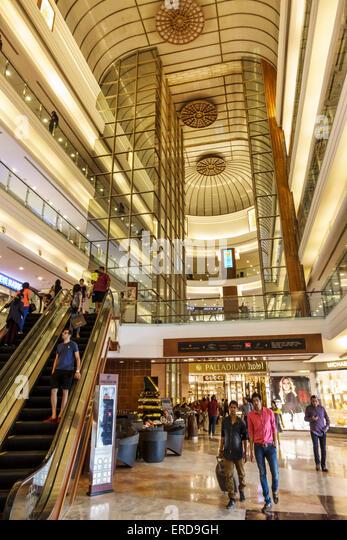 Mumbai India Asian Lower Parel High Street Phoenix mall inside interior Palladium shopping escalators - Stock Image