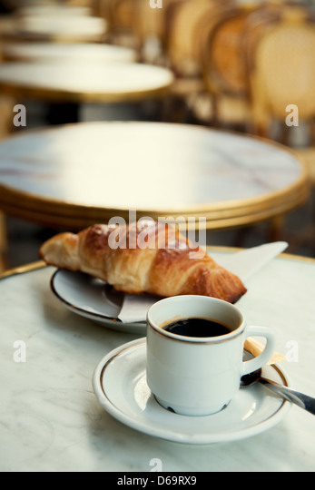 Pastry and cup of coffee on table - Stock Image