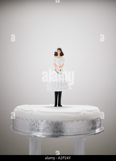 Bride figurine in a wedding dress and trousers - Stock Image