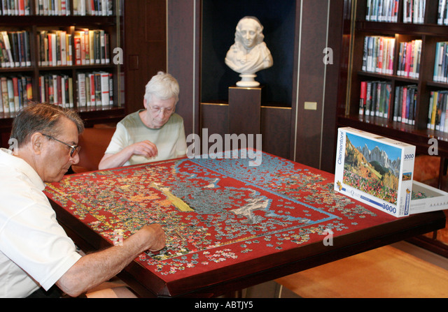 Puerto Rico Atlantic Ocean Holland America Line ms Noordam Explorations Cafe jigsaw puzzle man woman pieces - Stock Image