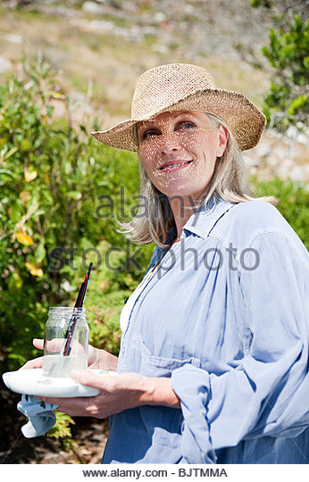 Woman with artistic equipment - Stock Image