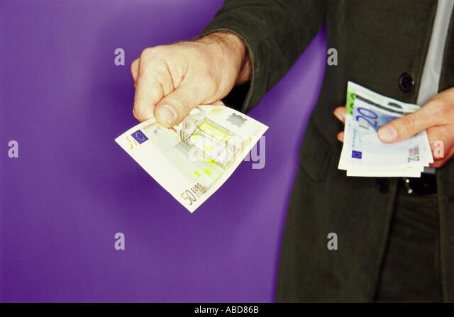Man handling euro notes - Stock Image