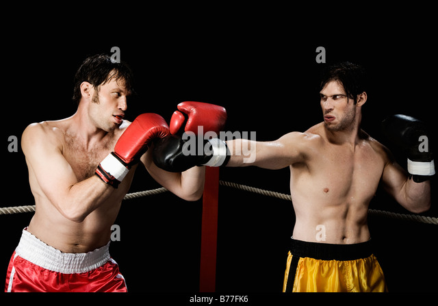 Boxers fighting boxing ring - Stock Image