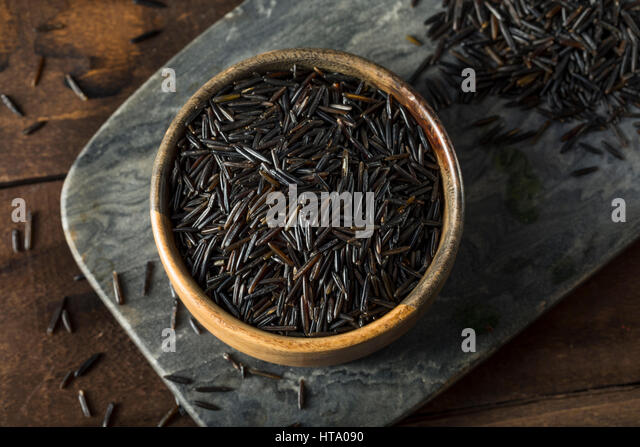 Organic Dry Black Wild Rice in a Bowl - Stock Image