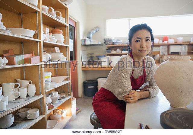 Portrait of confident female potter in studio - Stock Image