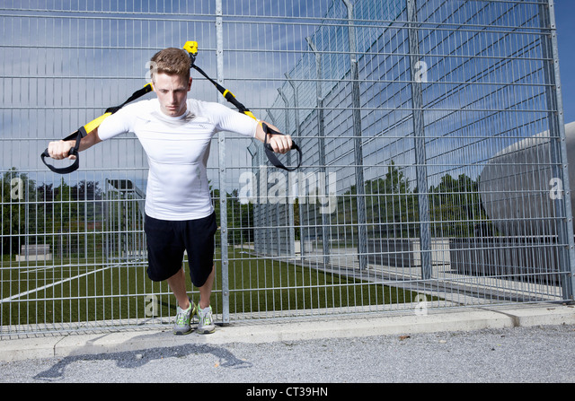 Man working out in industrial area - Stock Image