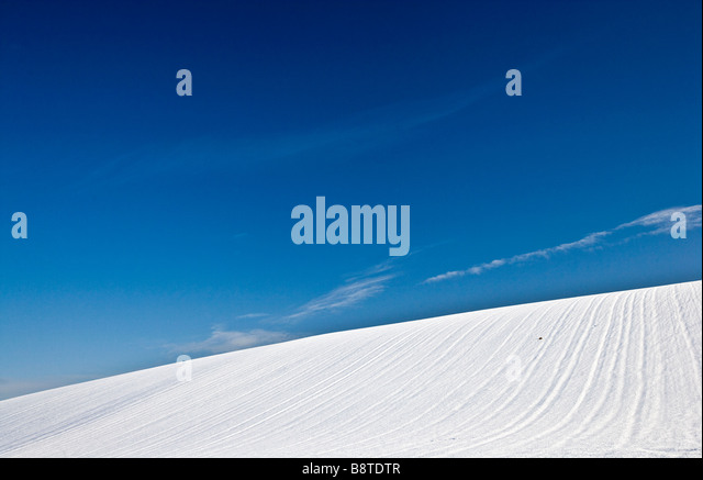 A sunny snowy winter abstract minimalist landscape view or scene on the Downs in Wiltshire England UK - Stock Image