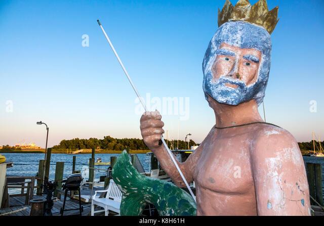 North Carolina NC Morehead City Bogue Sound waterfront Olympus Dive Center Poseidon statue - Stock Image