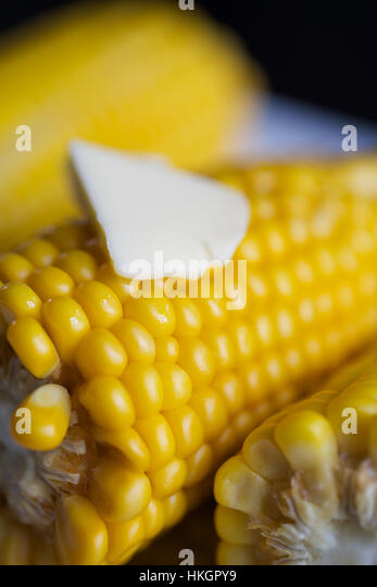 slice of butter on top of cooked corn. delicacy, healthy eating, maize, food. - Stock-Bilder