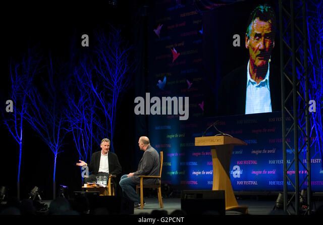 Michael Palin speaking on stage at Hay Festival 2016 - Stock Image