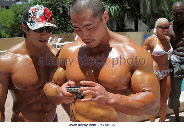 Miami Florida Hyatt Regency Miami Hotel Musclemania Universe and & Expo Fitness Pageant contestants Asian man - Stock Image