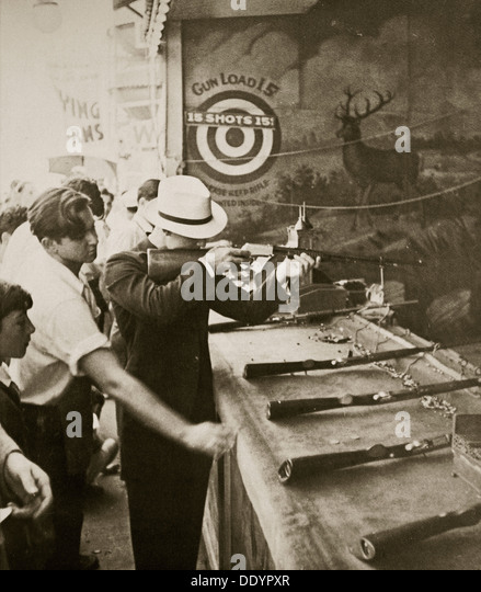 Shooting gallery at the amusement park, Coney Island, New York, USA, early 1930s. Artist: Unknown - Stock Image