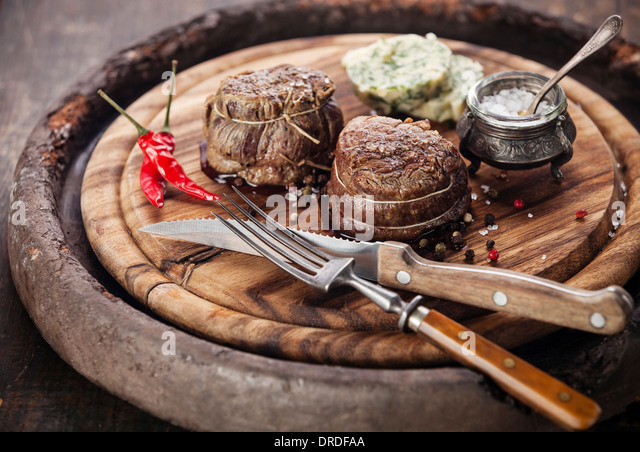 Beef steak filet mignon and butter with herbs - Stock Image