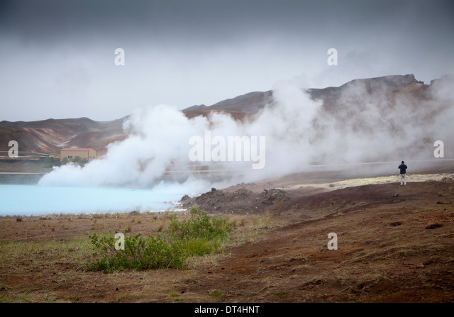 Stream rising from small lake used for thermal energy, near Strokkur, Iceland - Stock Image