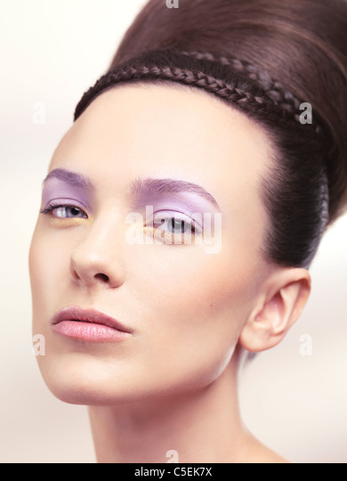 Beauty portrait of a young woman with soft pastel color makeup and beautiful hairstyle - Stock Image