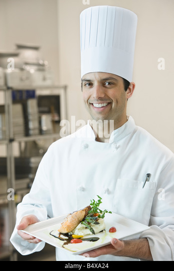 Chef presenting gourmet entree - Stock Image