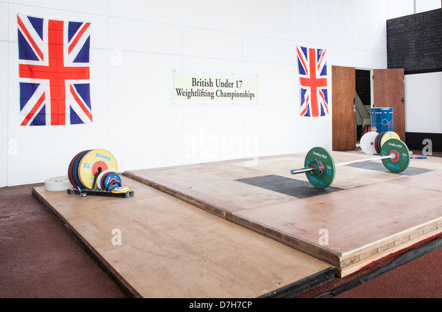 GBR, British weightlifting championships. GB flags and Olympic weightlifting bar with Olympic weights. London 2012. - Stock Image