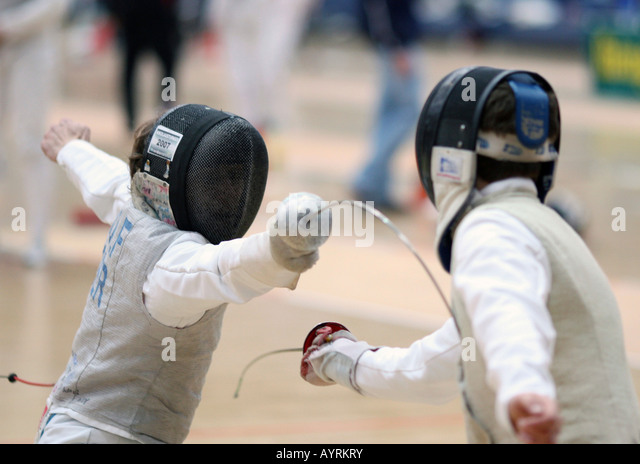 Foilsman Leon Wolf attacking (fencing) - Stock Image