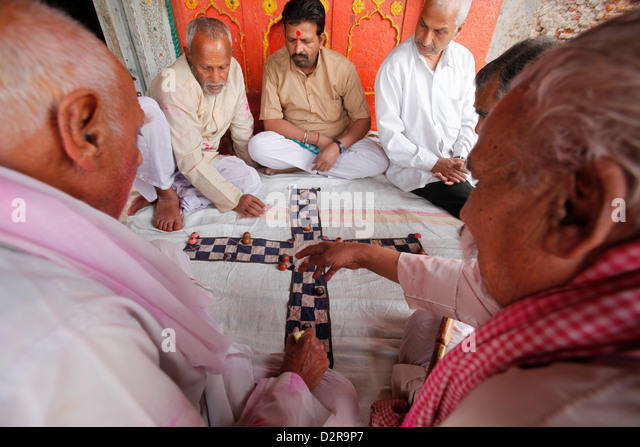 Senior men playing a game, Mathura, Uttar Pradesh, India, Asia - Stock Image