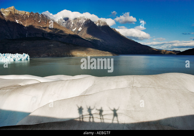 Glacier climbers silhouettes Torres del Paine National Park Chile South America - Stock Image