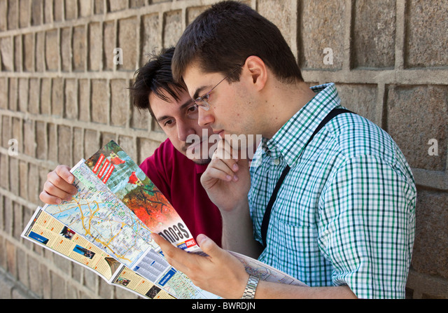 Western tourists consulting map and guide in Seoul South Korea. JMH3947 - Stock Image