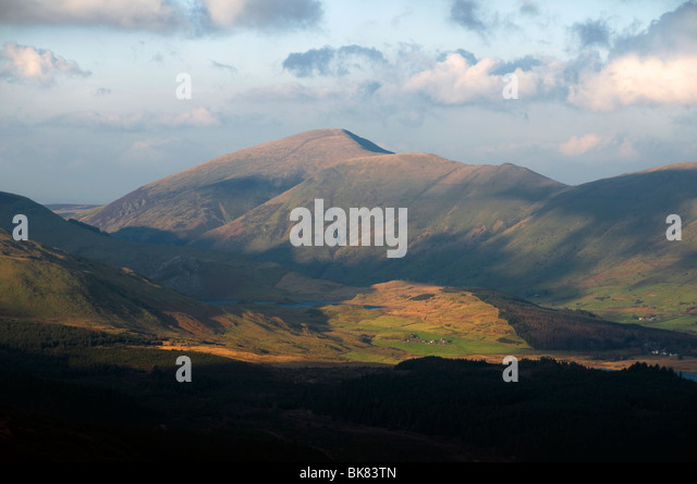 Sunset on Moel Eilio mountain, from near Beddgelert, Snowdonia, North Wales, UK - Stock Image