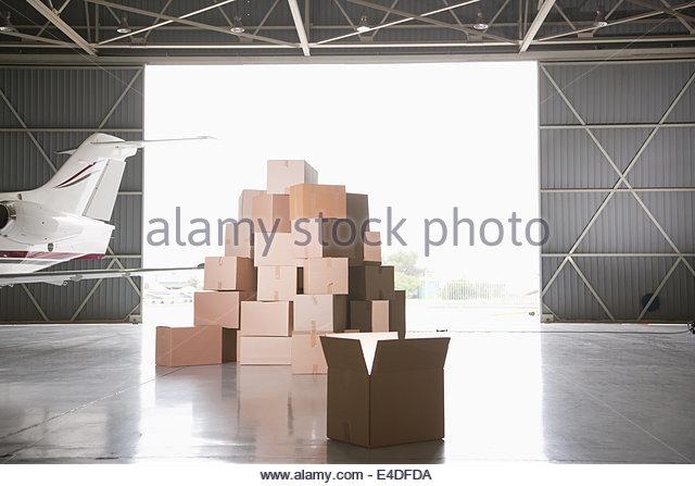 Stack of boxes in hangar - Stock-Bilder
