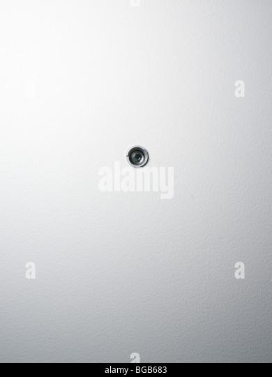 spy hole in a door - Stock Image