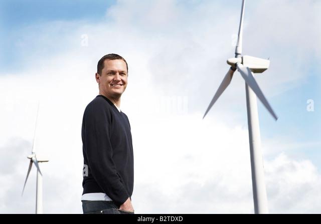 Man on wind farm - Stock Image