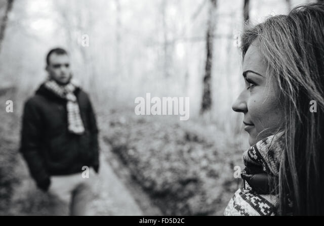 couple walking on a winter park - Stock Image