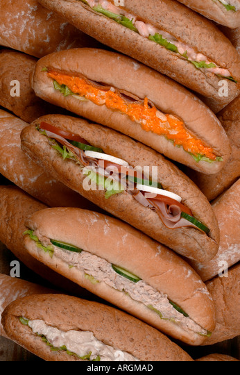 SELECTION OF SALAD SANDWICHES IN BREAD ROLLS - Stock Image