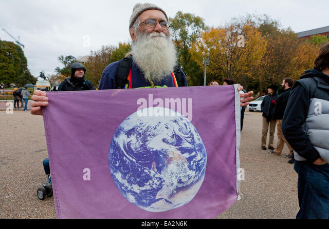 Climate activist holding Earth Day flag - Washington, DC USA - Stock Image