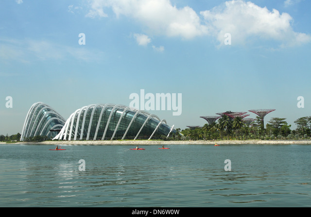 Building at the Gardens By The Bay. Singapore. People in Kayaks in foreground. - Stock Image
