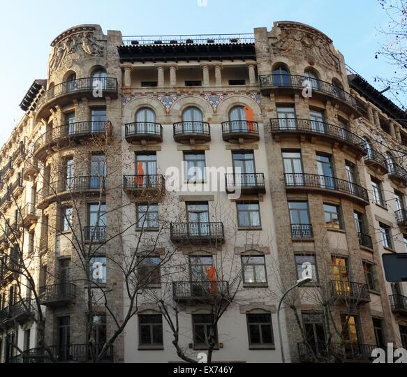 Façade of apartments dating to the early twentieth century, Barcelona, Spain - Stock Image