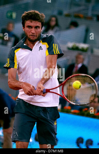 Madrid, Spain. 9th May 2013. Giles Simon of France plays a double handed backhand to Andy Murray of Great Britain - Stock Image