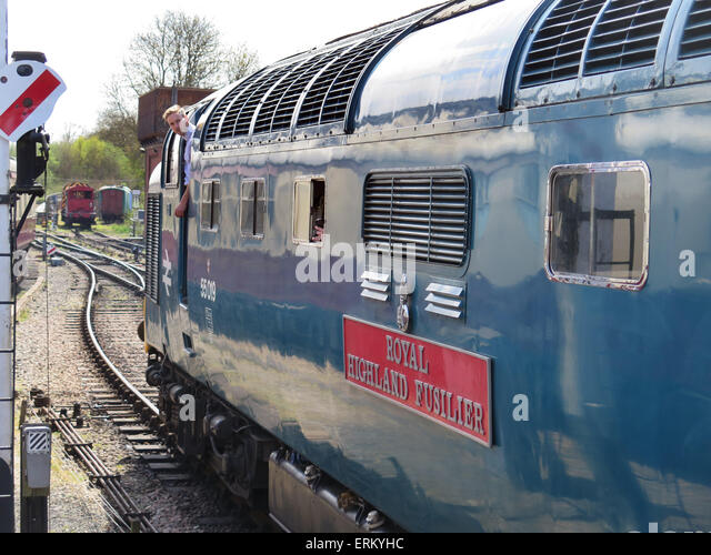 The driver of Preserved Deltic diesel D9019 'Royal Highland Fusilier' ( new number 55019 ) checks for the - Stock Image