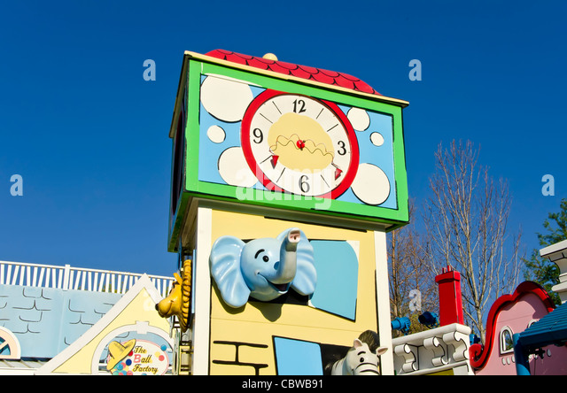 Curious George Goes To Town kids attraction buildings and clock at Universal Studios Orlando  Florida - Stock Image