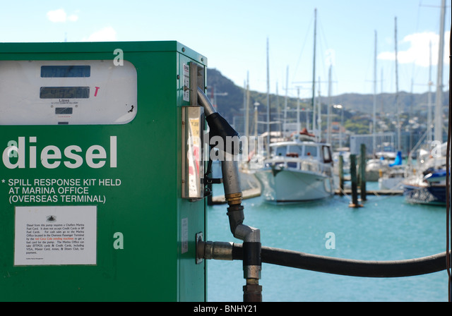 A marine diesel pump in Wellington, with sailing yachts in background NZ - Stock Image