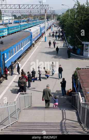 Railway station with passengers and trains, Almaty, Kazakhstan - Stock Image