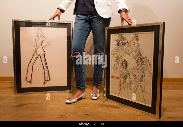 London, UK. 10 September 2014. Gallery Director Connie Gray with fashion illustrations by Brian Stonehouse. Gray - Stock-Bilder