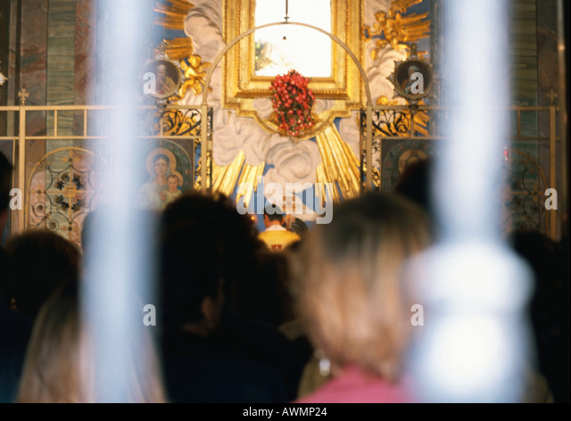 People attending mass, rear view - Stock Image