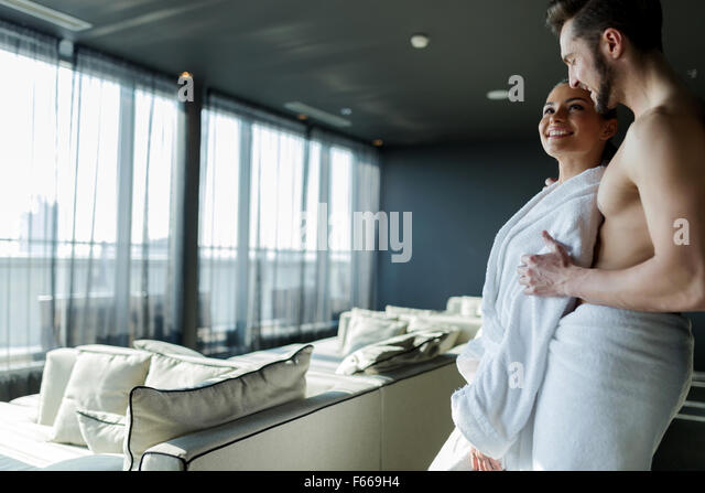 Couple in love relaxing in a wellness hotel with a beautiful panoramic view - Stock Image
