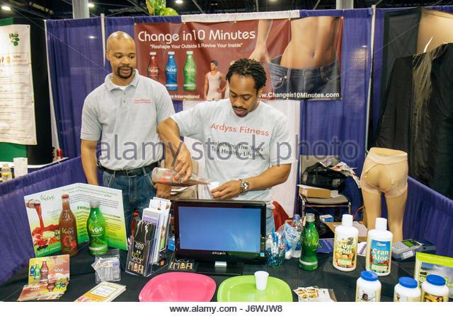 Miami Beach Miami Florida Beach Convention Center centre Health and Fitness Expo exhibitors Black man free sample - Stock Image