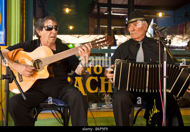 Musicians play guitar and accordion in street cafe in La Boca Buenos Aires Argentina South America - Stock Image