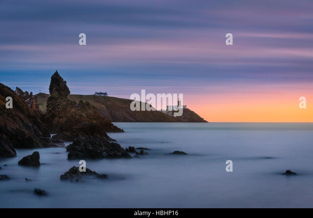 Howth Lighthouse at sunrise - Stock Image